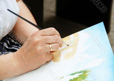 Artist painting hand