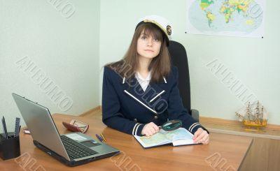 Girl - the sea captain with a atlas