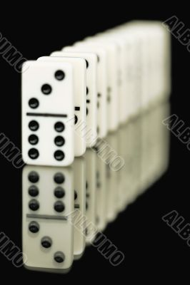 Bones of dominoes on a black background