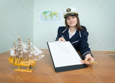 Girl - sea captain with a tablet and pen