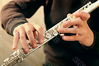 Flute player`s hands