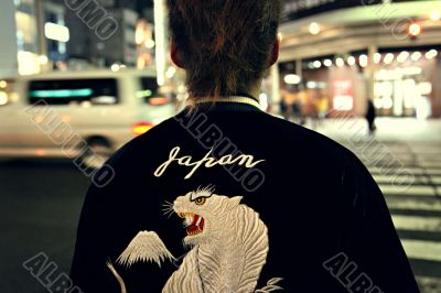 Young guy`s back with sign `Japan`
