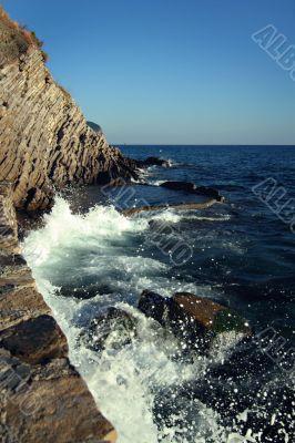 Sea-foam and rocks