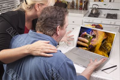 Couple In Kitchen Using Laptop - Music Entertainment