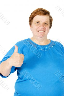 elderly woman is putting her thumb up on white