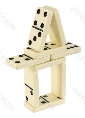 Tower constructed of dominoes bones