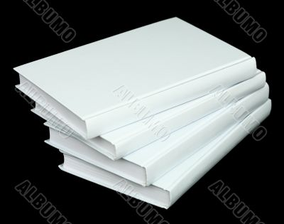 Pile from four book volumes on a black