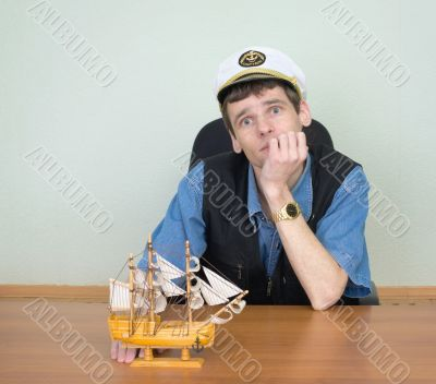 Man with model of a sailing vessel