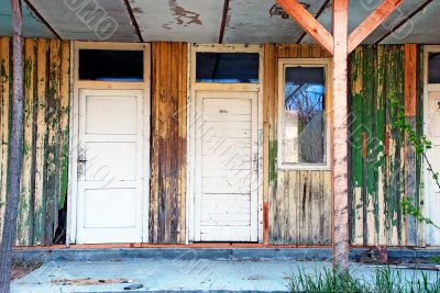 old wooden doors abandoned house