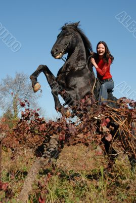 rearing stallion and happy girl
