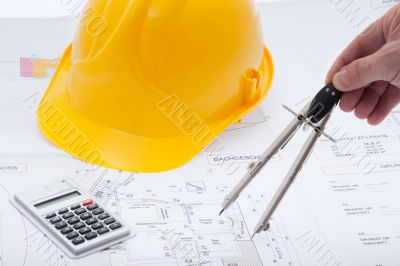Building plan with safety helmet