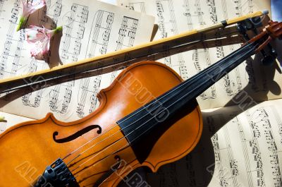 Old violin, fiddle-stick and music sheet