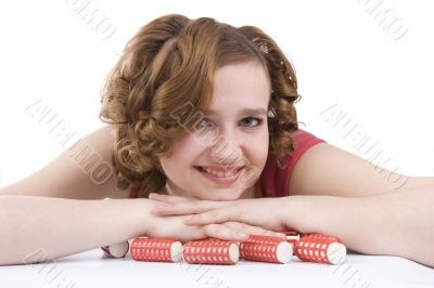 Woman with curlers in her hair.