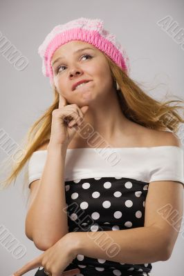 beautiful thoughtful girl in pink beret