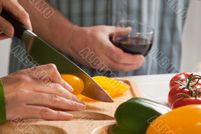 Woman Slicing Vegetables on Cutting Board