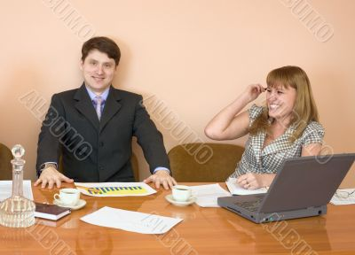Business people sits at the table