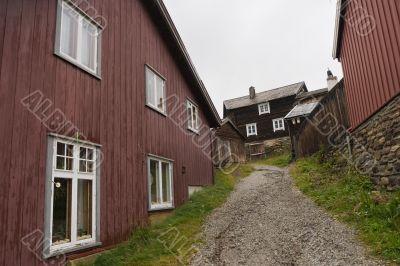 Footpath between wooden houses