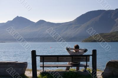 relaxed man on the bank of lake