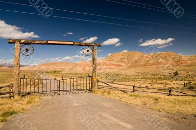 A gate and a fence in desert, wild west