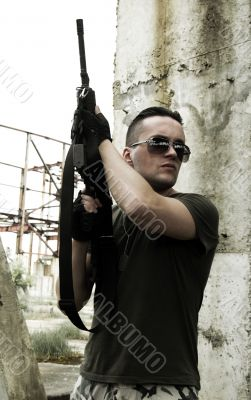 Soldier in camouflage and glasses