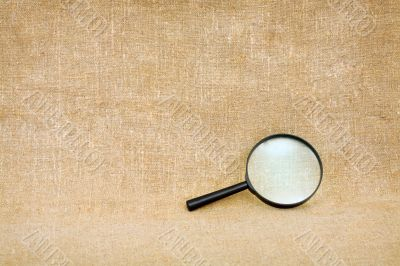 Magnifier against a brown sacking