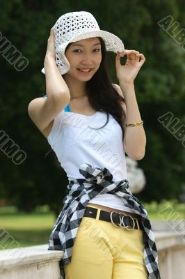 Young Asian woman with a summer hat.