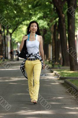 Young Asian woman walking.