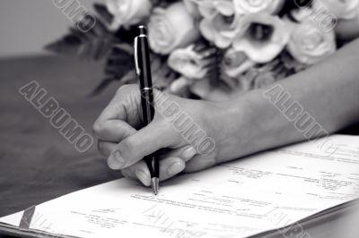 Woman`s hand near a wedding bouquet