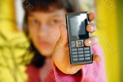 Teen girl showing her mobile phone