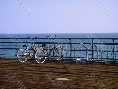 Two romantic bicycles near the ocean