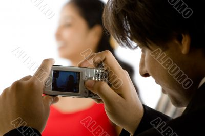 photograph of  girl with cellphone camera