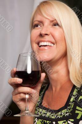 Beautiful Blonde Enjoying Wine