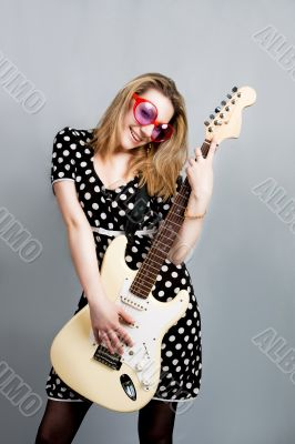 pretty woman with guitar smiling