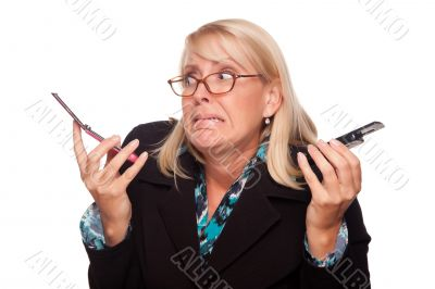 Frustrated Woman with Two Cell Phones