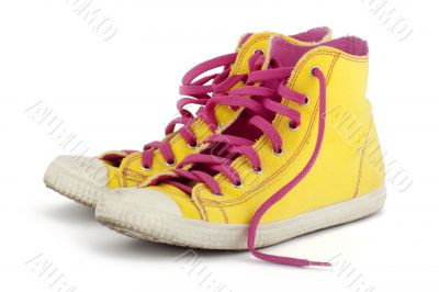 yellow shoes with pink shoelace
