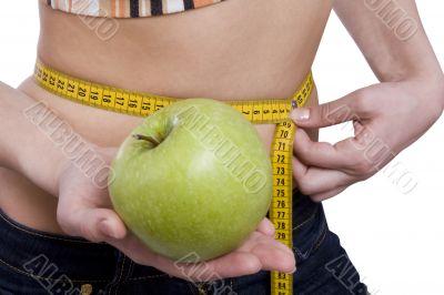 Waist is 65.5 centimeters.Woman measure tape apple