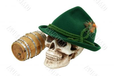 Alpine hat on skull next to an oak barrel