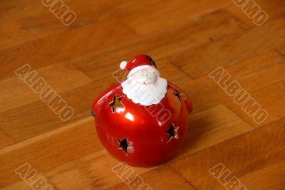 Christmas candlestick on parquet floor