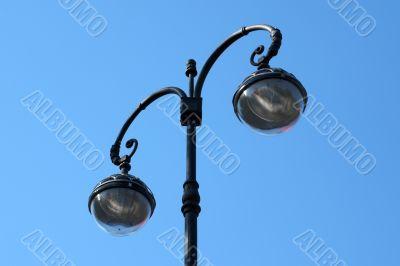 Vintage Street Lamp on Blue Background