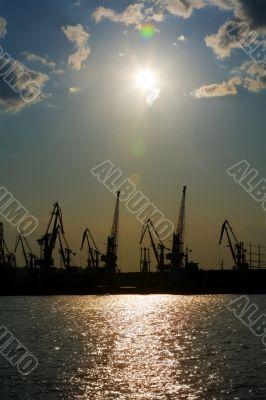 Silhouettes of harbor cranes