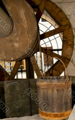 Old wooden well and bucket