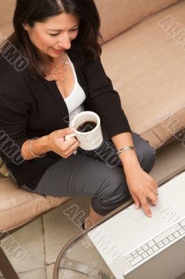 Hispanic Woman with Coffee and Laptop