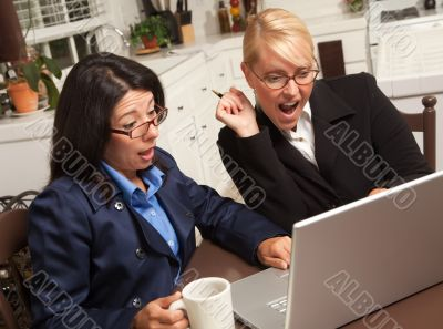 Businesswomen Celebrate Success on the Laptop