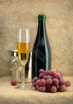 Still-life with champagne wine and grapes