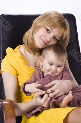 Mother and daughter sitting in a chair