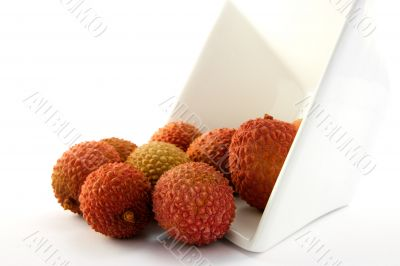 Lychee Spilling out of a Dish