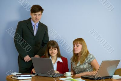 Girls at a desktop and their chief