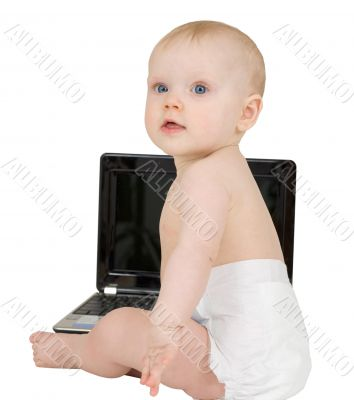 Baby sitting on a white background with laptop