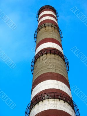 chimney with white and red lines over blue sky