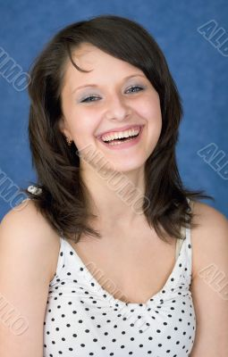 Laughing, happy girl on a blue background